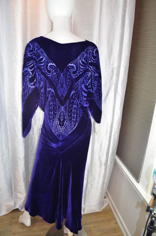 Charles and Patricia Lester Couture Gown  Purple burnout silk velvet bias cut gown. Excellent condition.  Measurements in inches: Note: 2+/- inches give due to bias cut and larger the size shorter the gown Bust - 34-40 Waist - 24-28 Hip -