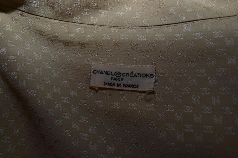 Women's Chanel Creations 1970s Cream CC Logo Print Silk Tie Neck Blouse For Sale