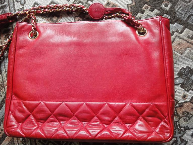 Vintage CHANEL red calfskin classic shoulder tote bag with gold tone chains and CC charm. Classic purse.
