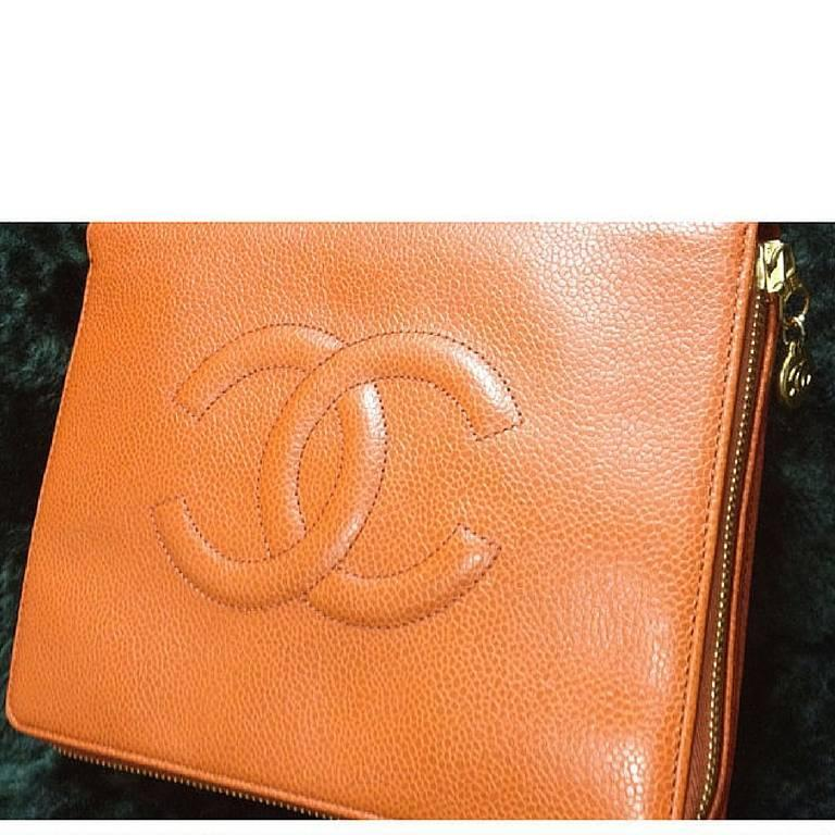 MINT. 90's Vintage CHANEL caviar leather travel and cosmetic case pouch, mini bag in orange, rare piece. Best vintage Chanel for the season