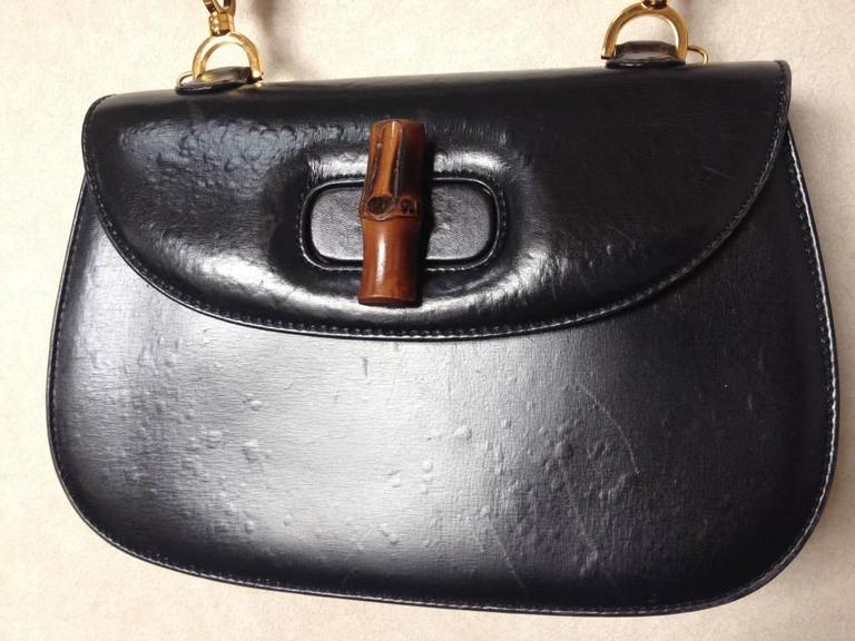 Black Vintage Gucci Genuine Leather Handbag With Bamboo Handle And Red Interior For