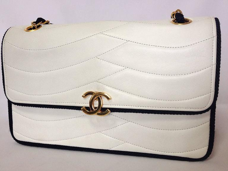 MINT. 80's rare vintage Chanel white flap bag with navy rope string and gold chains. Very rare purse from the era.