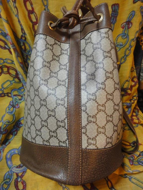Well-liked 1980s Vintage Gucci Plus monogram and leather hobo bucket purse  IQ09