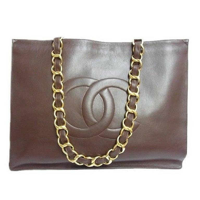 Vintage CHANEL brown calfskin large tote bag with gold tone chain handles and CC For Sale