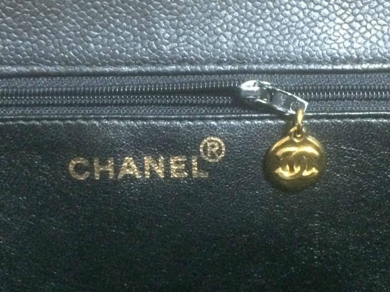 Vintage CHANEL black caviar extra large tote bag with gold tone chain straps. 8