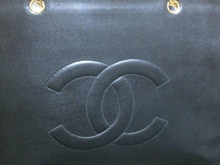 Vintage CHANEL black caviar extra large tote bag with gold tone chain straps. 3