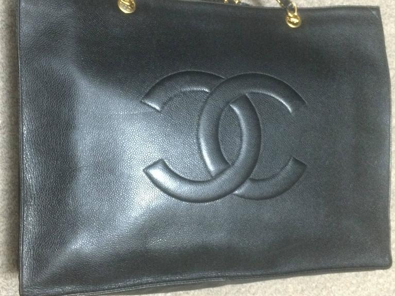 Vintage CHANEL black caviar extra large tote bag with gold tone chain straps. 2
