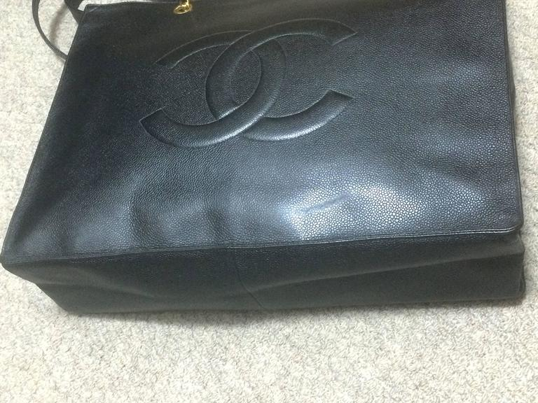 Vintage CHANEL black caviar extra large tote bag with gold tone chain straps. 6
