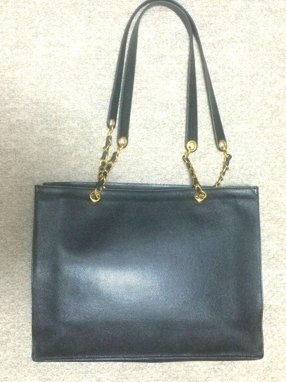 Vintage CHANEL black caviar extra large tote bag with gold tone chain straps. 4