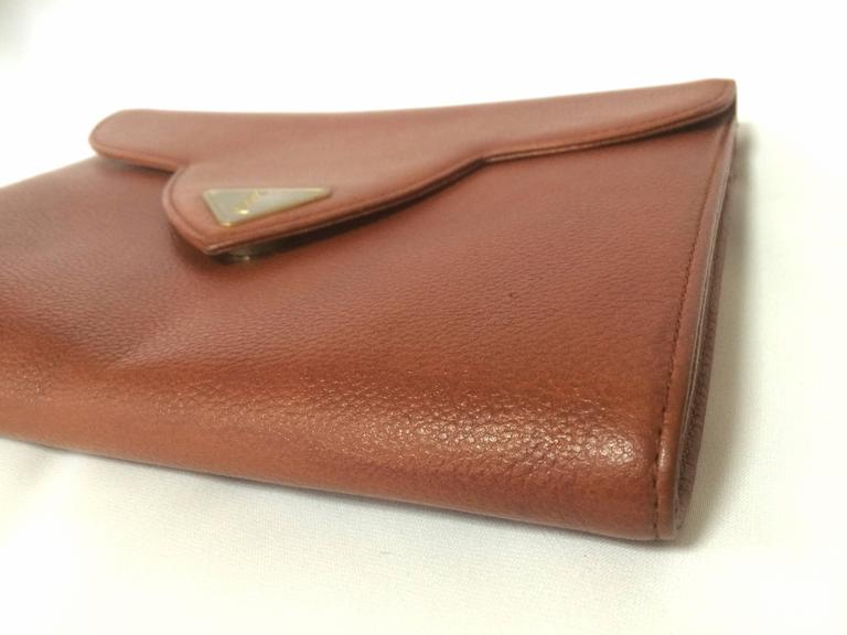 Vintage Yves Saint Laurent genuine brown leather clutch purse with beak tip flap 3