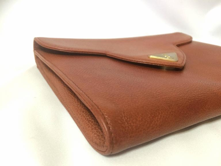 Vintage Yves Saint Laurent genuine brown leather clutch purse with beak tip flap 4