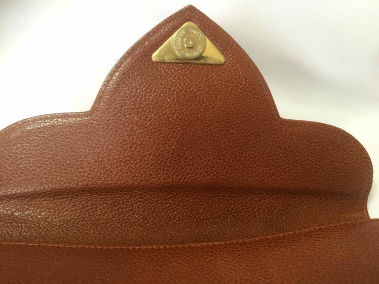 Vintage Yves Saint Laurent genuine brown leather clutch purse with beak tip flap 5
