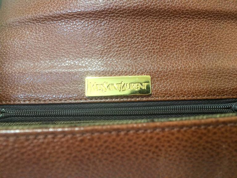 Vintage Yves Saint Laurent genuine brown leather clutch purse with beak tip flap 6
