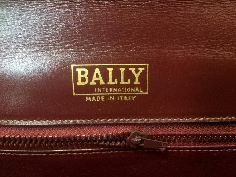 Vintage BALLY genuine wine suede leather clutch bag, mini purse with golden logo For Sale 4