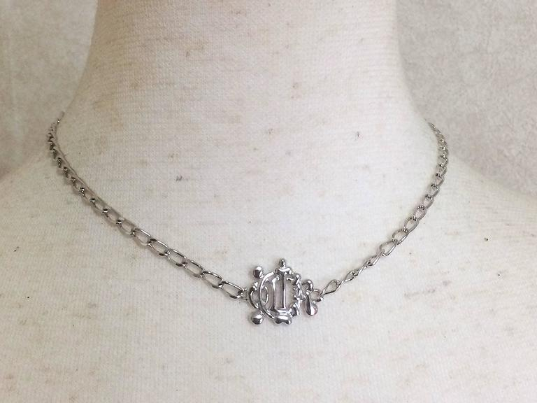MINT. Vintage Christian Dior silver tone chain necklace with logo motif top. For Sale 2