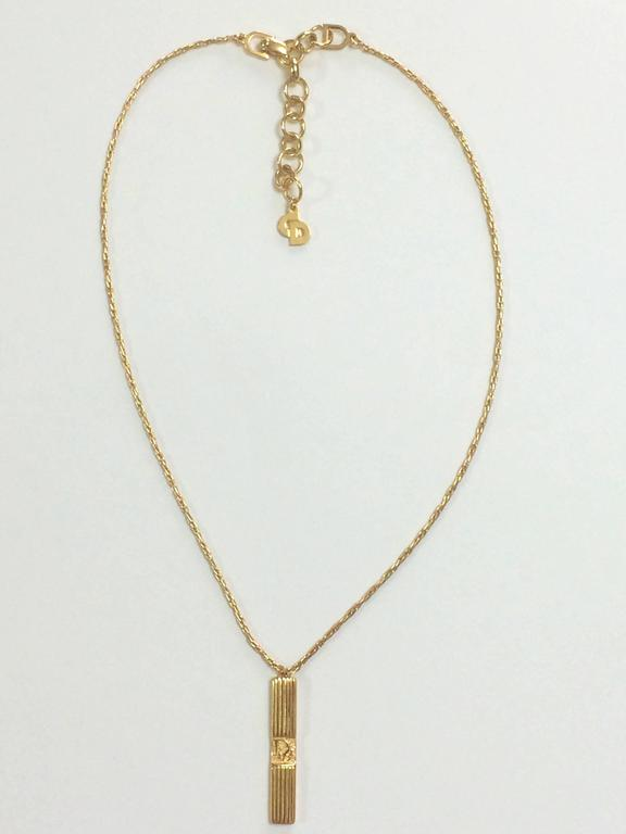Vintage Christian Dior golden skinny chain necklace with stick logo pendant top 4
