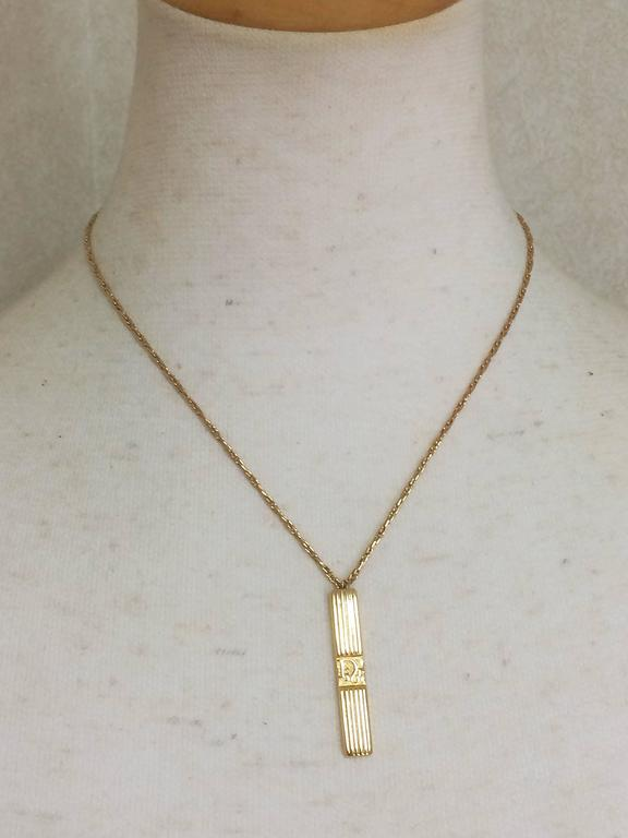 Vintage Christian Dior golden skinny chain necklace with stick logo pendant top For Sale 1