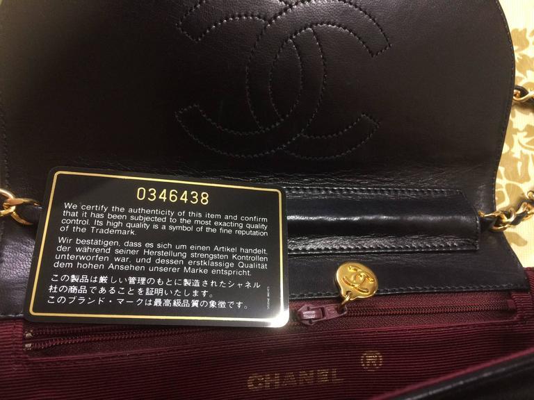 Vintage Chanel black lambskin half moon 2.55 chain shoulder bag with golden CC. For Sale 1