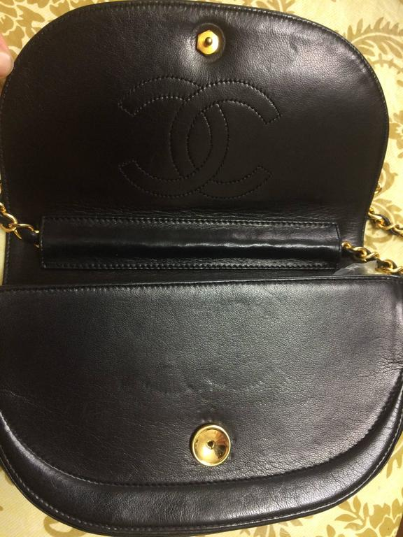 Women's Vintage Chanel black lambskin half moon 2.55 chain shoulder bag with golden CC. For Sale