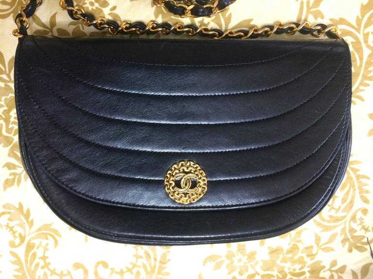 1980's Chanel black lambskin half moon shape 2.55 shoulder bag with golden round flower CC motif closure. Rare masterpiece purse.  Introducing another old masterpiece from CHANEL back in the 80's. Classic but unique halfmoon shape mini 2.55 black