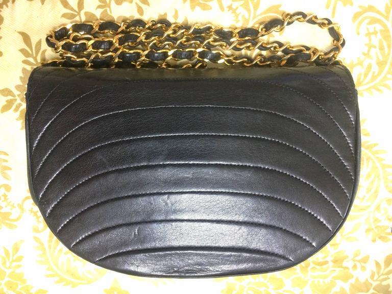 Black Vintage Chanel black lambskin half moon 2.55 chain shoulder bag with golden CC. For Sale
