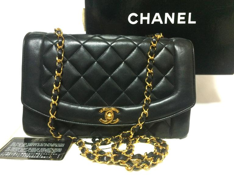 1990s. MINT. Vintage CHANEL black lambskin classic 2.55 chain shoulder bag with golden CC. Best vintage purse for rest of your life.  Here is another one of the most classic vintage bags from Chanel back in the 90s.... This classic black lambskin