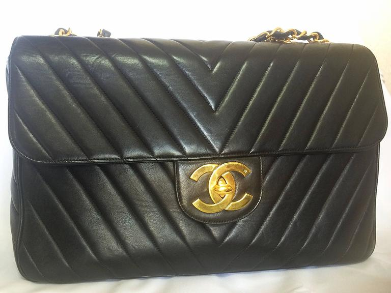 Vintage CHANEL classic jumbo, large 2.55 black shoulder bag with chevron stitch 2