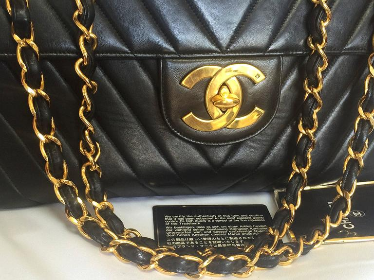 Vintage CHANEL classic jumbo, large 2.55 black shoulder bag with chevron stitch 3