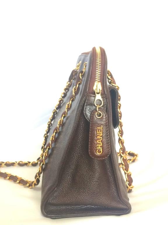 Women's Vintage CHANEL dark brown caviar leather chain shoulder tote bag with golden CC. For Sale