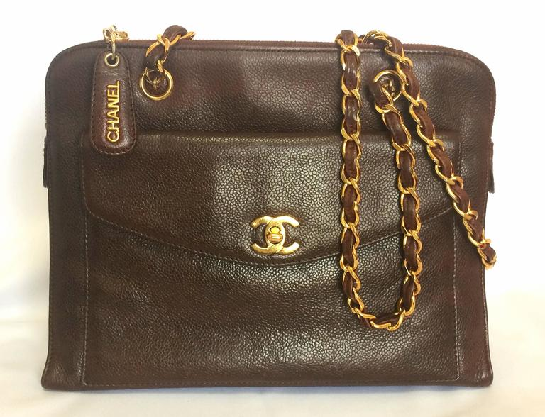 1990s. Vintage CHANEL dark brown caviar leather chain shoulder tote bag with golden CC closure. Classic and daily use bag  This is a vintage caviarskin chain shoulder tote bag in dark brown from 90's CHANEL.  Featuring a golden CC turn lock