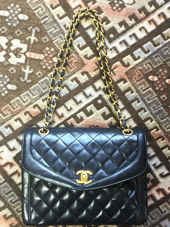 1990s. Vintage Chanel black lambskin chain shoulder 2.55 shoulder bag, pentagon flap.  If you are a vintage CHANEL lover/collector, then this is a must-have piece for your collection! Introducing a very rare vintage CHANEL black chain shoulder purse