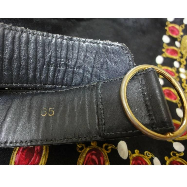 Vintage Celine black leather belt with golden carriage and horse motif. 65  4