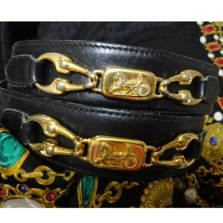 Vintage Celine black leather belt with golden carriage and horse motif. 65  3