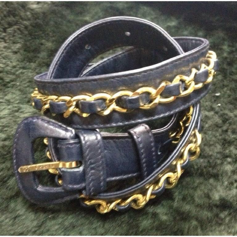 """1980s. Vintage CHANEL navy leather belt with gold tone chains. Must-have belt from CHANEL. size 69 ~ 75 , 27"""", 28"""", 29"""", 29.5"""".   Here is another fabulous piece from CHANEL back in the 80's. Introducing a navy leather and chain belt"""