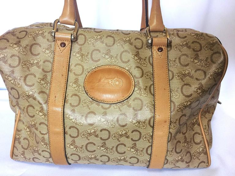 1980s. Vintage Celine classic beige and brown macadam and blason pattern handbag, speedy design duffle bag with embossed logo. Unisex. 