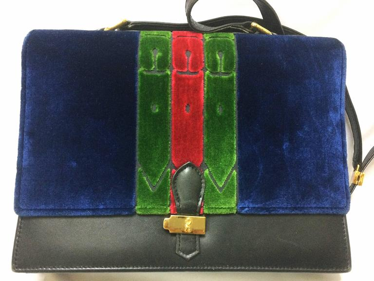1980's Vintage Roberta di Camerino red, navy, and green ribbon velvet shoulder purse with golden R motif closure. Classic bag.