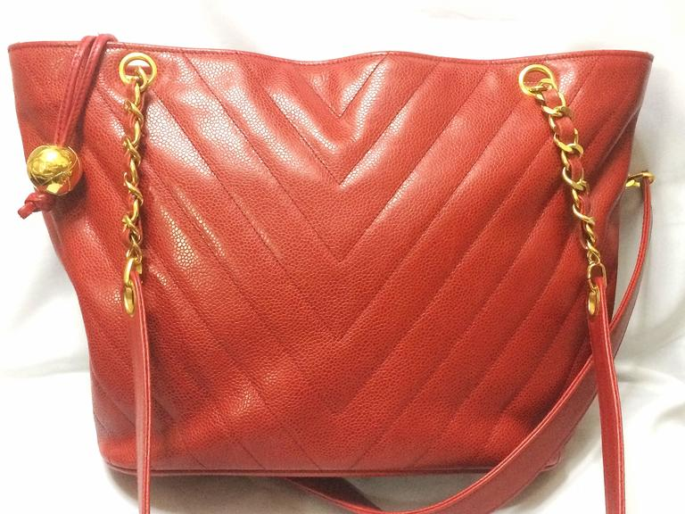 Red Vintage CHANEL red caviar v stitch, chevron style chain shoulder tote bag. For Sale