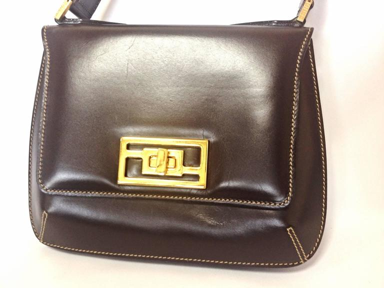1990s. Vintage FENDI genuine dark brown leather handbag with golden FF logo at closure. Rare masterpiece  Introducing another masterpiece leather bag from FENDI back in the 90's. This classic handbag would never go out of style. Very classic and yet