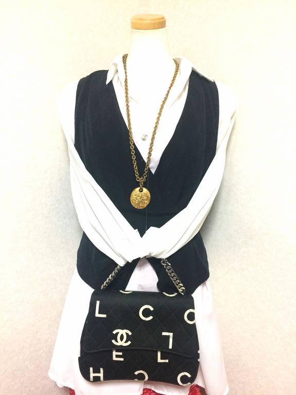 Vintage CHANEL black fabric handbag with silver tone chain strap and white logo 10