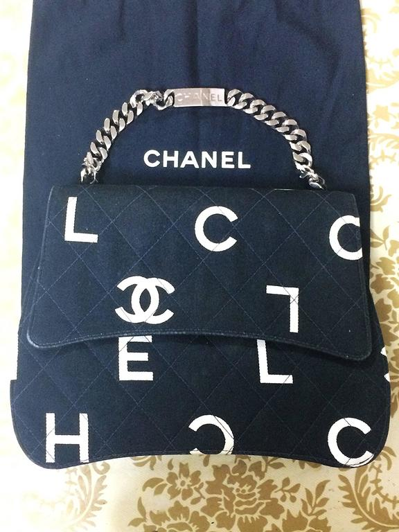 Vintage CHANEL black fabric handbag with silver tone chain strap and white logo 3