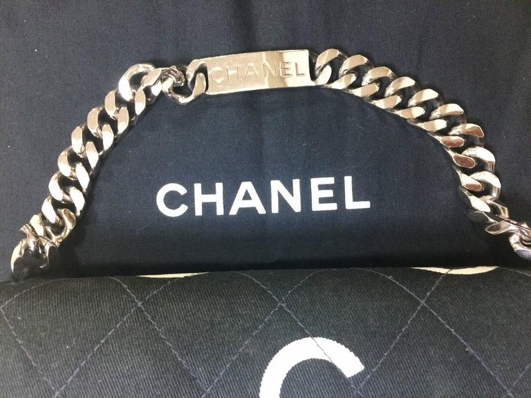 Vintage CHANEL black fabric handbag with silver tone chain strap and white logo 7