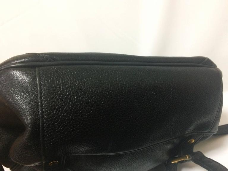 80's vintage MCM genuine leather black backpack with golden logo motifs. Unisex For Sale 2