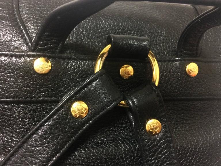 Women's or Men's 80's vintage MCM genuine leather black backpack with golden logo motifs. Unisex For Sale