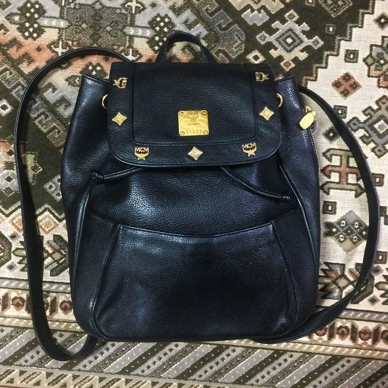 80's vintage MCM genuine leather black backpack with golden logo motifs. Unisex For Sale 5