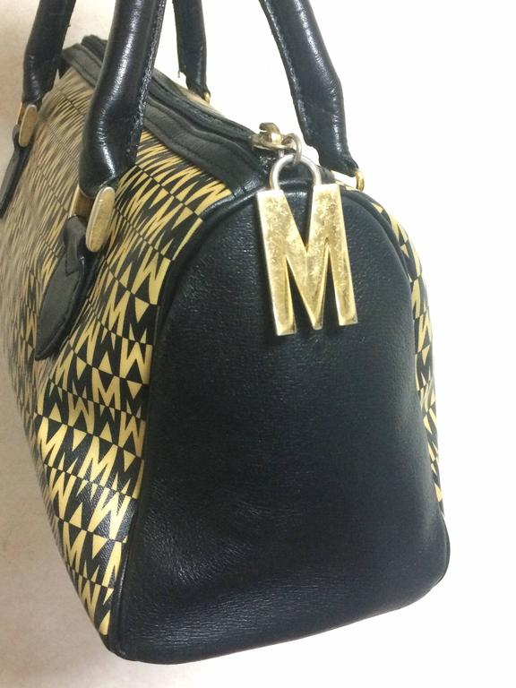 Moschino Vintage Moschino Black And Ivory Beige Logo M Print Handbag, Mini Duffle Bag