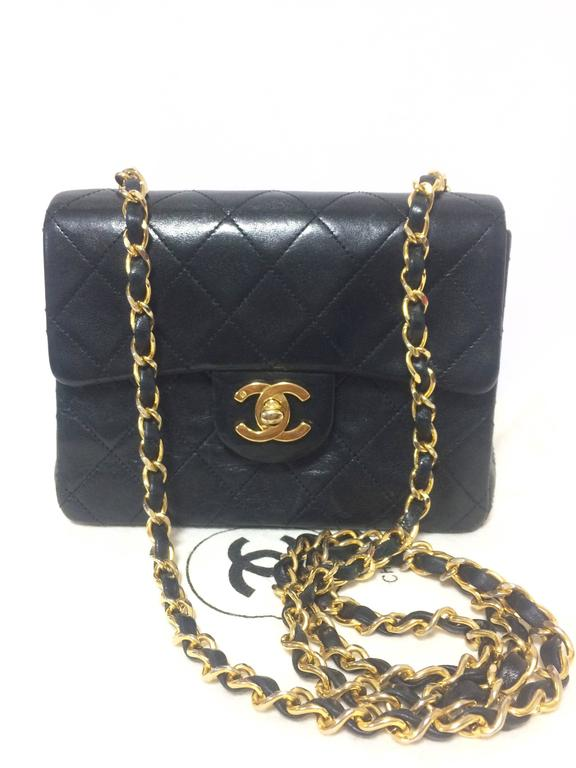 1990s. Vintage CHANEL black lamb leather flap chain shoulder bag, classic 2.55 mini purse with gold tone CC closure.  Introducing one of the most popular pieces from CHANEL back in the early 90's, vintage Chanel classic black lambskin 2.55 mini