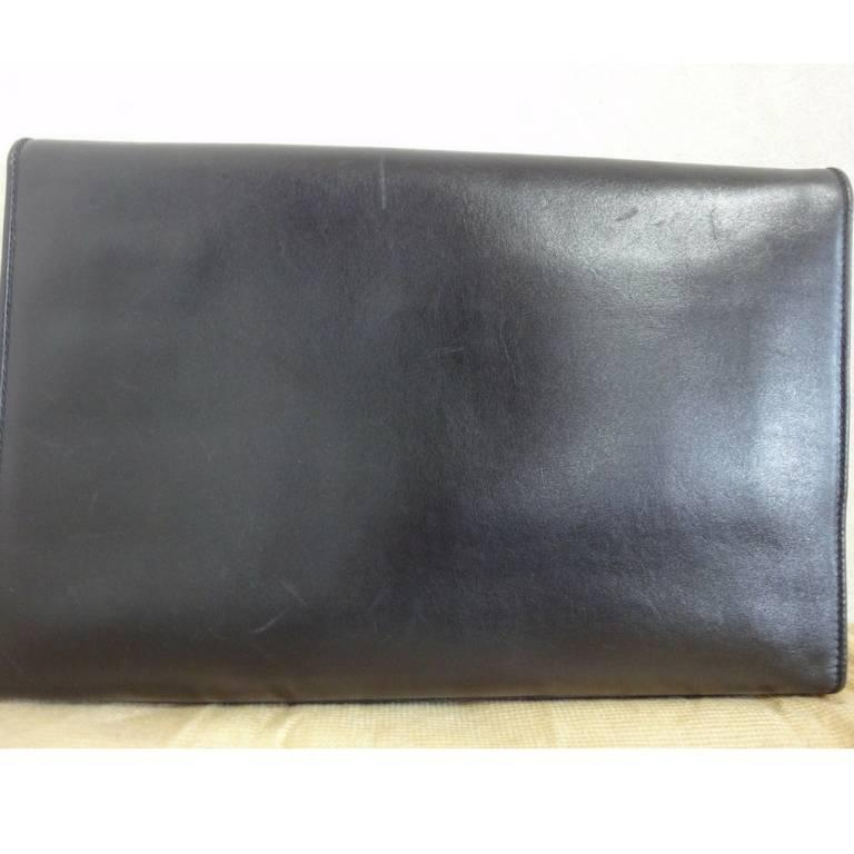 Vintage Celine black calfskin leather clutch bag with iconic golden logo motif. 4