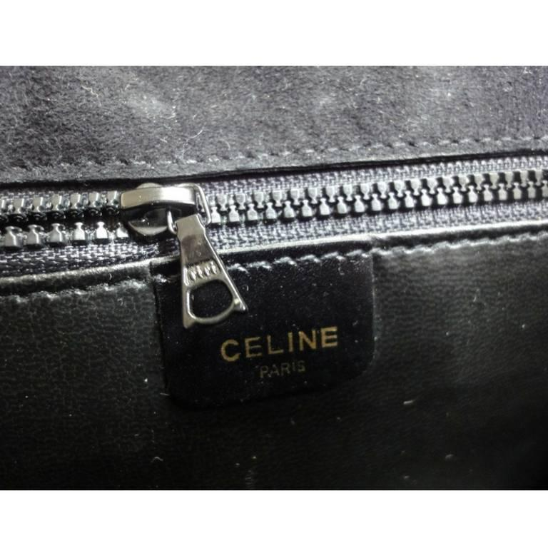 Vintage Celine black calfskin leather clutch bag with iconic golden logo motif. 6