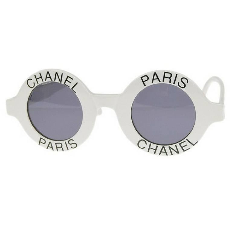 1990s. Vintage CHANEL white round frame sunglasses with black CHANEL PARIS print on it. Must have. One-of-a-kind sunglasses back in the old era.  Retro and mod style are now in trend again!  This is a vintage CHANEL white round frame sunglasses that