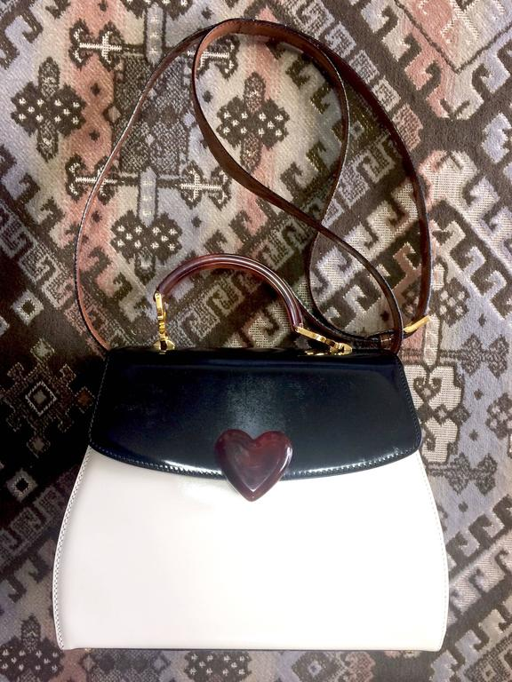 1990s. Vintage MOSCHINO white, black, brown patent enamel handbag, shoulder bag with heart motif. Adorable purse by Red Wall.  Introducing a beautiful tricolor enamel leather bag, shoulder bag from Moschino back in the 90's, produced by Red Wall.